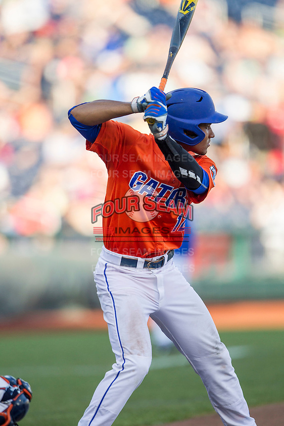 Florida Gators shortstop Richie Martin (12) at bat against the Virginia Cavaliers in Game 13 of the NCAA College World Series on June 20, 2015 at TD Ameritrade Park in Omaha, Nebraska. The Cavaliers beat the Gators 5-4. (Andrew Woolley/Four Seam Images)
