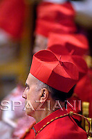 Segrtary of State Vatuican Cardinal Tarcisio Bertone A newly elevated cardinal attends a Mass celebrated by Pope Benedict XVI, seen in the background wearing yellow, in which he gave each new cardinal a golden ring, inside St. Peter's Basilica, at the Vatican, Sunday, Nov. 25, 2007.