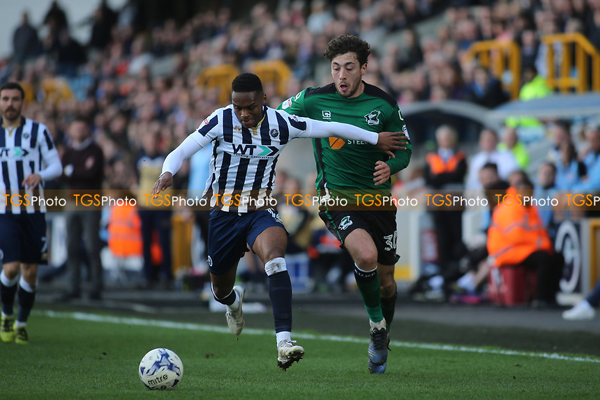 Mahlon Romeo of Millwall tries to shield the ball from Scunthorpe's Matt Crooks during Millwall vs Scunthorpe United, Sky Bet EFL League 1 Football at The Den on 1st April 2017