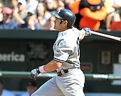 Baltimore, MD - May 10, 2009 -- New York Yankees centerfielder Johnny Damon (18) watches the flight of his 3 run home run in the 7th inning against the Baltimore Orioles at Oriole Park at Camden Yards in Baltimore, MD on Sunday, May 10, 2009.  The Yankees won the game 5 - 3..Credit: Ron Sachs / CNP.(RESTRICTION: NO New York or New Jersey Newspapers or newspapers within a 75 mile radius of New York City)