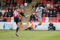 Harry Pell of Cheltenham Town and Danny Andrew of Grimsby during the Sky Bet League 2 match between Cheltenham Town and Grimsby Town at the The LCI Rail Stadium,  Cheltenham, England on 17 April 2017. Photo by PRiME Media Images / Mark Hawkins.