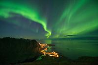 Autumn northern lights over the village of Å, Moskenesøy, Lofoten Islands, Norway