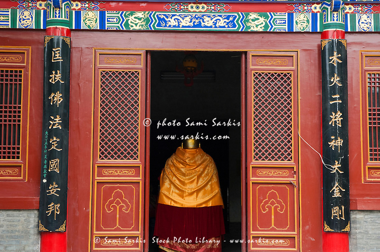 Gold clothed statue at Wo Long Si (The Temple of the Sleeping Dragon), Xian, Shaanxi, China.