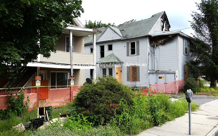 TORRINGTON, CT, 07  JULY 15 - The City of Torrington is preparing to ask a judge to order this burned building on Main Street to be torn down. Alec Johson/ Republican-American