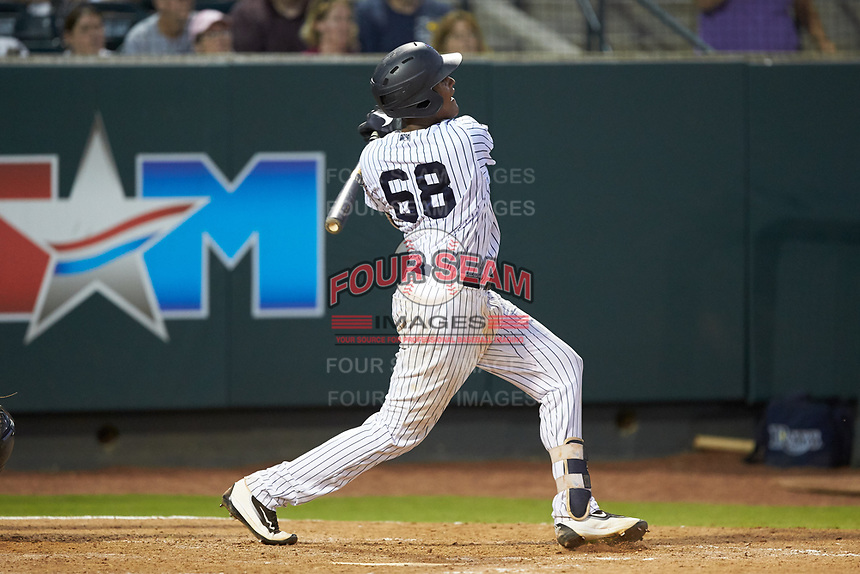 Carlos Tatis (68) of the Pulaski Yankees follows through on his swing against the Princeton Rays at Calfee Park on July 14, 2018 in Pulaski, Virginia. The Rays defeated the Yankees 13-1.  (Brian Westerholt/Four Seam Images)