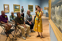 NWA Democrat-Gazette/CHARLIE KAIJO Museum Educator Kim Crowell of Rogers asks attendees to think of what the painting &quot;Along The River&quot; By William Trost <br />Richards reminds them of at the Crystal Bridges museum in Bentonville, AR on Monday, September 11, 2017. Creative Connections is a program for individuals in the early stages of Alzheimer&acirc;&euro;&trade;s or dementia and their care partners. Museum Educators facilitate interactive discussions of artworks in the galleries, followed by hands-on art activities in the studio. The discussions on the works are designed to stimulate memories and emotions between Alzheimer's patients and their caretakers.
