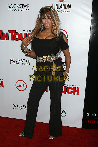 TRACI BINGHAM.In Touch Weekly's Summer Stars Party 2008 held at Social Hollywood, Hollywood, California, USA,  .22 May 2008..full length black top trousers cleavage hand on hip.CAP/ADM/MJ.©Michael Jade/Admedia/Capital Pictures