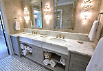 """The master bathroom is spacious and well-lit. """"At Home"""" with Margaret Lowery in her Lake Christine Drive home in Belleville, IL on July 24, 2019. <br /> Photo by Tim Vizer"""