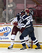 Steven Santini (BC - 6), Cory MacIntosh (StFX - 42) - The Boston College Eagles defeated the visiting St. Francis Xavier University X-Men 8-2 in an exhibition game on Sunday, October 6, 2013, at Kelley Rink in Conte Forum in Chestnut Hill, Massachusetts.