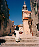 CROATIA, Korcula, Dalmatian Coast, Island, rear view of a nun walking towards church
