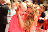 "Michelle Heaton and daughter arriving for the premiere of ""Pudsey the Dog the movie"" at the Vue cinema, Leicester Square, London. 13/07/2014 Picture by: Steve Vas / Featureflash"