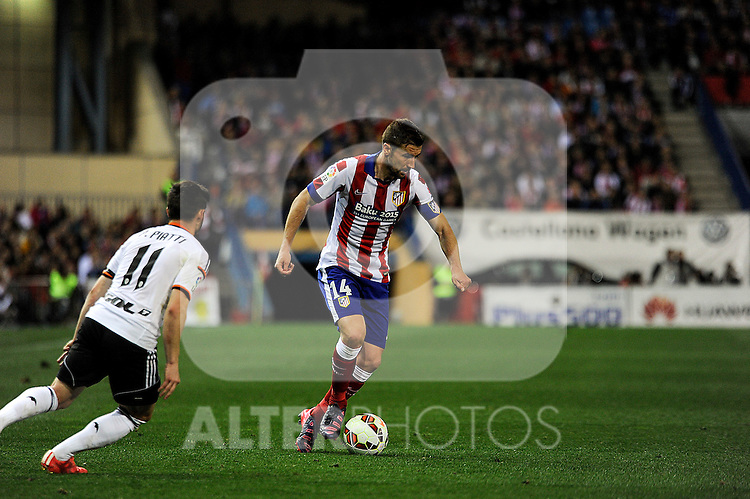 Atletico de Madrid´s Gabi and Valencia CF´s Pablo Piatti during 2014-15 La Liga match between Atletico de Madrid and Valencia CF at Vicente Calderon stadium in Madrid, Spain. March 08, 2015. (ALTERPHOTOS/Luis Fernandez)