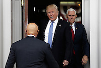 United States President-elect Donald Trump (C) and Vice President-elect Mike Pence (R) greet Peter Kirsanow (L) at the clubhouse of Trump International Golf Club, in Bedminster Township, New Jersey, USA, 20 November 2016.<br /> Credit: Peter Foley / Pool via CNP /MediaPunch