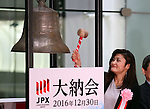 December 30, 2016, Tokyo, Japan - Rio de Janeiro Olympics women's wrestling gold medalist Kaori Icho <br /> rings a bell with a wooden hammer during a ceremony to celebrate the last trading day of 2016 at the Tokyo Stock Exchange on Friday, December 30, 2016. Japan's share prices fell 30.77 yen to close at 19,114.37 yen at the Tokto Stock Exchange, but finished the highest close in 20 years for the last day trading of the year.  (Photo by Yoshio Tsunoda/AFLO) LWX -ytd-