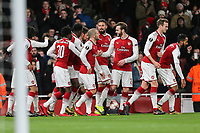 Mathieu Debuchy of Arsenal celebrates with team mates after he scores the opening goal of the game during the UEFA Europa League match between Arsenal and FC BATE Borisov  at the Emirates Stadium, London, England on 7 December 2017. Photo by David Horn.