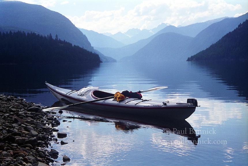 A loaded kayak awaits its paddler at dusk along the shores of Ross Lake.