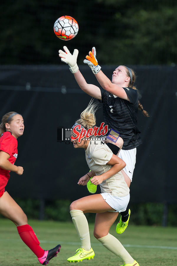 Lindsay Preston (1) of the Wake Forest Demon Deacons leaps over teammate Bayley Feist (9) to make a save during second half action against the Georgia Bulldogs at Spry Soccer Stadium on August 23, 2015 in Winston-Salem, North Carolina.  The Deacons defeated the Bulldogs 4-0.   (Brian Westerholt/Sports On Film)