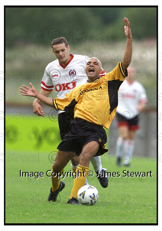 19th August 2000              Copyright Pic : James Stewart .Ref :                           .File Name : stewart08-clyde v livingston                        .BRIAN MCPHEE IS CAUGHT BY JACK ROSS......Payments to :-.James Stewart Photo Agency, Stewart House, Stewart Road, Falkirk. FK2 7AS      Vat Reg No. 607 6932 25.Office : +44 (0) 1324 630007        Mobile : 07721 416997.Fax     : +44 (0) 1324 630007.E-mail : jim@jspa.co.uk.If you require further information then contact Jim Stewart on any of the numbers above.........