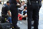 First aid responders attend to a woman passed out from lack of oxygen on the 16th Street Mall in downtown Denver, Colorado on August 21, 2008.  Four days before the Democratic National Convention kicks off at the nearby Pepsi Center emergency workers, police, and first responders are on call in the event of accidents and emergencies.
