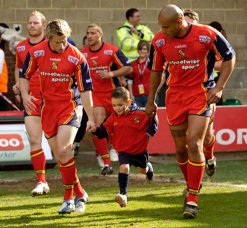 Photo: Richard Lane..London Broncos v Hull FC. Engage Super League. 20/03/2005..The mascot is lead out by Mark McLinden and Solomon Haumono.