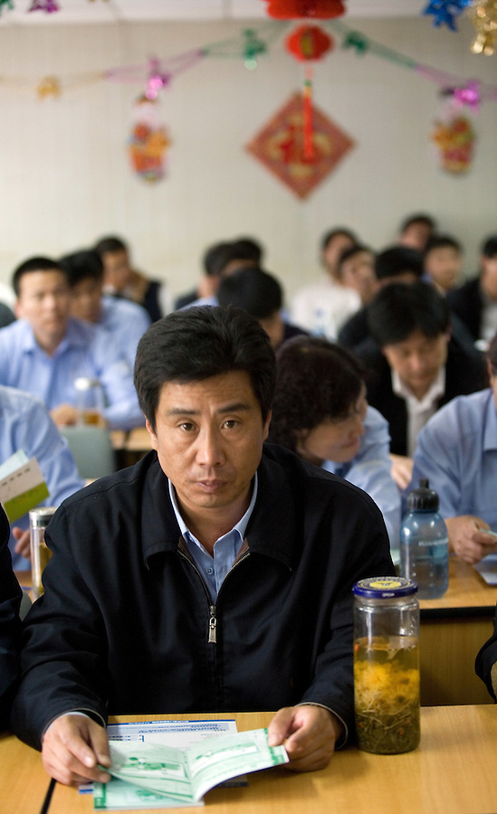 Chinese taxi drivers take a mandatory English class in Beijing. With 500,000 foreign tourists expected for the Olympics, taxi drivers who can't speak English could be an embarrassment and distract from the $40 billion being poured into rebuilding the city for the games.