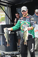 NWA Democrat-Gazette/FLIP PUTTHOFF <br /> Matt Arey of Shelby, N.C., shows a pair of bass from his catch Friday April 15, 2016 that has him in fourth place going into today's semi-final round. Arey won the Walmart FLW Tour event at Beaver Lake last year and in 2014. He's the only angler in the history of FLW tournaments at Beaver Lake to tally back-to-back wins.