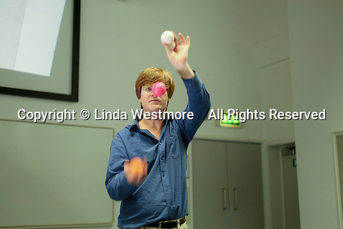 Colin Wright explains the mathematical patterns in juggling during the Science Circus Day, put on by the Science Museum's Outreach Team, University of Surrey.