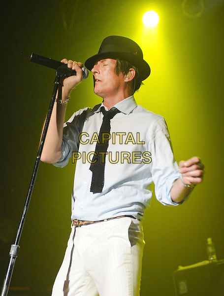 SCOTT WEILAND.performs live during his solo tour at HOB Anaheim in Anaheim, California, USA, May 23rd 2009..music concert gig show on stage performing half length black hat  fedora shirt tie white trousers microphone   singing                                                                .CAP/DVS.©Debbie VanStory/RockinExposures/Capital Pictures