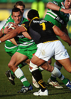 Manawatu first five Aaron Cruden takes on Serge Lilo during the Air NZ Cup preseason match between Manawatu Turbos and Wellington Lions at FMG Stadium, Palmerston North, New Zealand on Friday, 17 July 2009. Photo: Dave Lintott / lintottphoto.co.nz