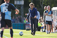 Wycombe Wanderers Manager Gareth Ainsworth passes the ball back during the Sky Bet League 2 match between Wycombe Wanderers and Plymouth Argyle at Adams Park, High Wycombe, England on 12 September 2015. Photo by Andy Rowland.