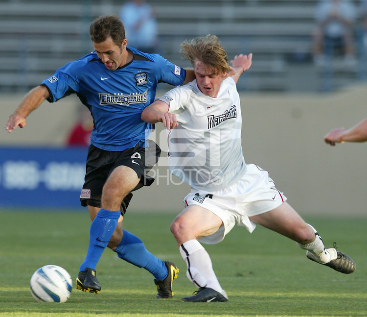 8 May 2004:  Earthquakes Brian Mullan dribbles the ball away from MetroStars Eddie Gaven at Spartan Stadium in San Jose, California.  Earthquakes and MetroStars are tied at 5-5..Mandatory Credit: Michael Pimentel/ISI