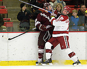 Brian Day (Colgate - 12), John Caldwell (Harvard - 15) - The Harvard University Crimson defeated the visiting Colgate University Raiders 6-2 (2 EN) on Friday, January 28, 2011, at Bright Hockey Center in Cambridge, Massachusetts.