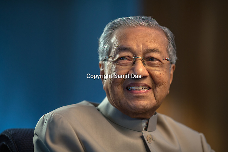 Tun Mahathir Mohamad, Malaysia's former prime minister, speaks during an interview in his office in the iconic Petronas Twin Towers in Kuala Lumpur, Malaysia, on Thursday, Feb. 25, 2016.