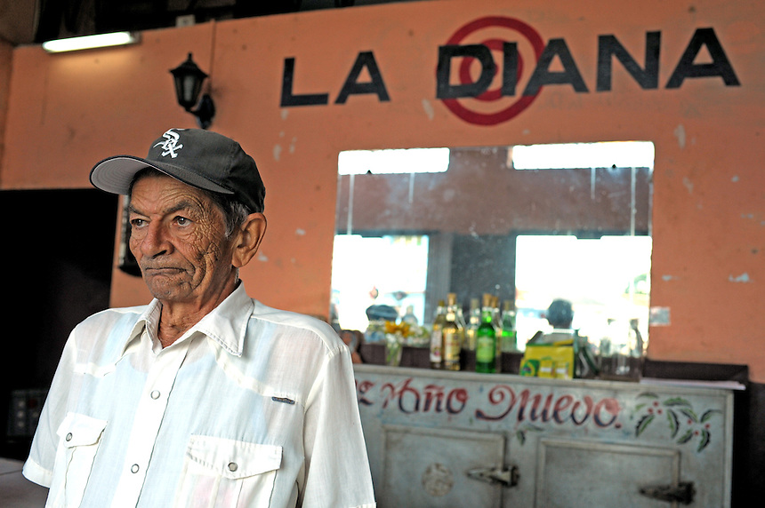 A regular at La Diana, a rum-only bar in Santa Clara, Cuba. MARK TAYLOR GALLERY