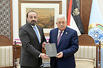 Palestinian President Mahmoud Abbas meets with acting-attorney general Akram Al-Khateeb, at Abbas's headquarter in the West Bank city of Ramallah, April 9, 2019. Photo by Thaer Ganaim