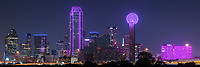 Another view of the Dallas Skyline Panorama in Pink as it celebrate another year of the Susan G Komen Race for the Cure.  Some of the city  buildings were lit up with the color pink in solidarity for the Susan B Komen event to raise money for the hope of bringing a cure for breast cancer. The downtown comes turns pink when the Bank of America, Reunion Tower and the Omni turn their buildings pink in solidarity with final evening of the Susan G Komen event in the city.A great cityscape for a good cause. We will donate 10% of the sale of this image to the Susan Komen foundation. Dallas skyline stock photos.
