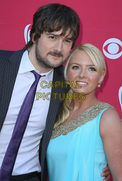 ERIC CHURCH & wife KATHERINE .44th Annual Academy Of Country Music Awards held at the MGM Grand Garden Arena, Las Vegas, Nevada, USA, .5th April 2009. .half beard facial hair purple length black tie suit turquoise dress .CAP/ADM/MJT.©MJT/Admedia/Capital Pictures