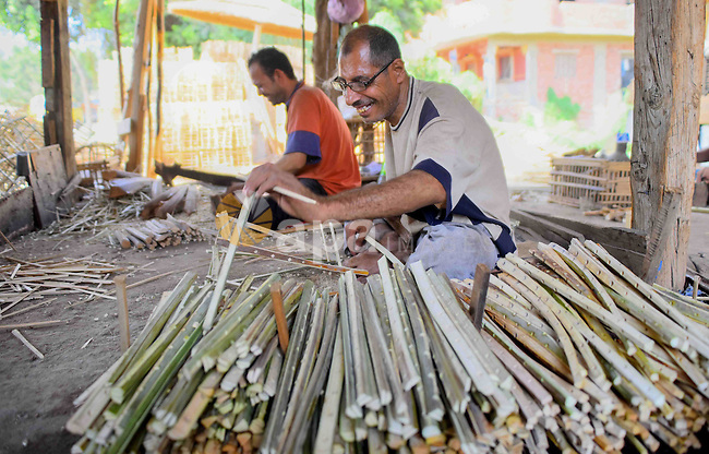 Egyptians weave straw-traditional products, at their workshop, in Cairo, Egypt, on September 7, 2016. Photo by Amr Sayed