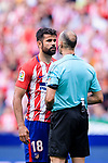 Diego Costa of Atletico de Madrid (L) gets a yellow card from FIFA Referee Alvarez Izquierdo (R) during the La Liga match between Atletico Madrid and Eibar at Wanda Metropolitano Stadium on May 20, 2018 in Madrid, Spain. Photo by Diego Souto / Power Sport Images