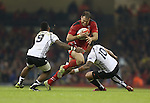 Wales centre Jamie Roberts goes for the gap between Nikola Matawalu and Josh Matawalu.<br /> Dove Men Series 2014<br /> Wales v Fiji<br /> Millennium Stadium<br /> 15.11.14<br /> ©Steve Pope-SPORTINGWALES