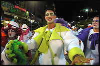 Members of Murga Contrafarsa are seen during the inaugural parade of the Uruguayan Carnival, January 30, 2004 in 18 de Julio Av. in Montevideo Uruguay. During the parade the different groups show to the audience their new costumes and make up, and sing part of their new repertoire.