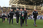 06 December 2015: Portland head coach Caleb Porter (center) leads his assistants to the team bench. The Columbus Crew SC hosted the Portland Timbers FC at Mapfre Stadium in Columbus, Ohio in MLS Cup 2015, Major League Soccer's championship game. Portland won the game 2-1.