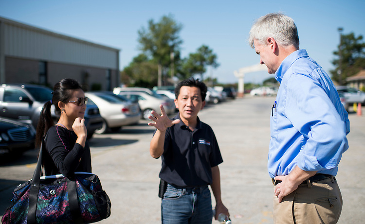 "UNITED STATES - SEPTEMBER 20: Senate candidate Rep. Bill Cassidy, R-La., right, speaks former Rep. Anh Joseph Cao, R-La., center, and his wife Hieu ""Kate"" Hoang during his stop at the health fair at the Mary Queen of Vietnam Catholic Church in east New Orleans on Saturday, Sept. 20, 2014. Cassidy is running against Sen. Mary Landrieu, D-La., in the 2014 midterm election. (Photo By Bill Clark/CQ Roll Call)"