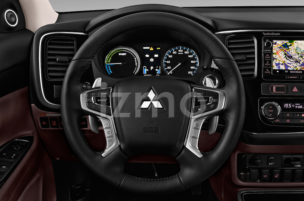 Car pictures of steering wheel view of a 2016 Mitsubishi Outlander Phev PHEV 5 Door Suv Steering Wheel