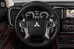 Car pictures of steering wheel view of a 2016 Mitsubishi Outlander Phev PHEV 5 Door Suv Steering Wheel