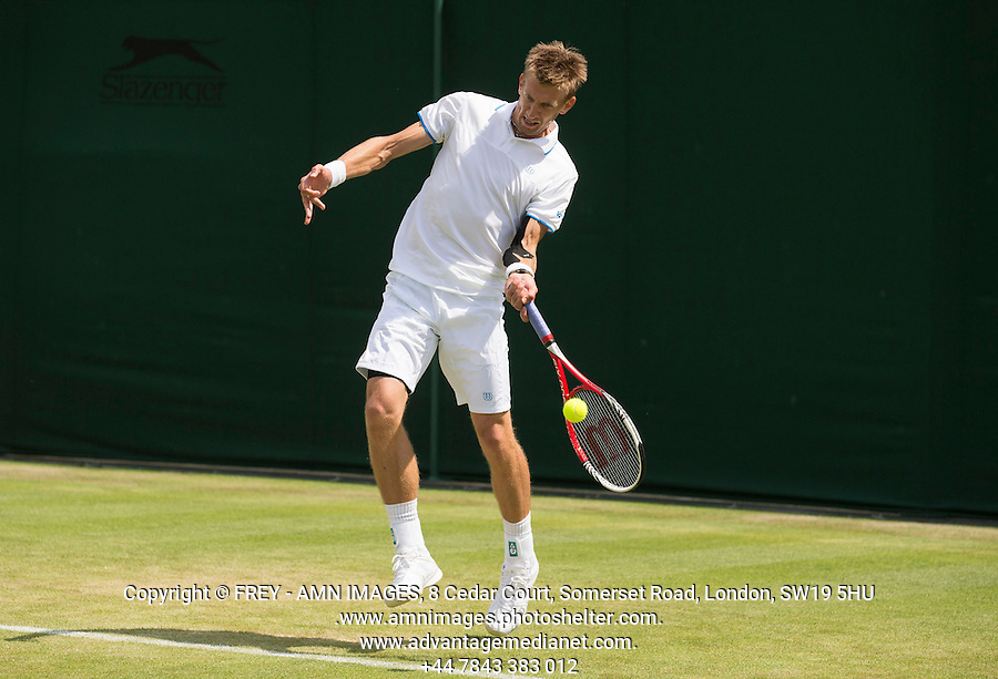 Jarkko Nieminen<br /> <br /> Tennis - The Championships Wimbledon  - Grand Slam -  All England Lawn Tennis Club  2013 -  Wimbledon - London - United Kingdom - Tuesday 25th June  2013. <br /> &copy; AMN Images, 8 Cedar Court, Somerset Road, London, SW19 5HU<br /> Tel - +44 7843383012<br /> mfrey@advantagemedianet.com<br /> www.amnimages.photoshelter.com<br /> www.advantagemedianet.com<br /> www.tennishead.net