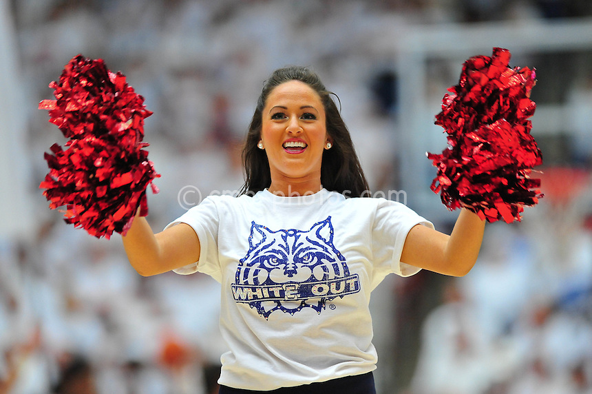 "Feb 19, 2011; Tucson, AZ, USA; An Arizona Wildcats dance team member wears white tee-shirt as part of a ""White Out"" promotion for a game against the Washington Huskies at the McKale Center.  The Wildcats won 87-86."