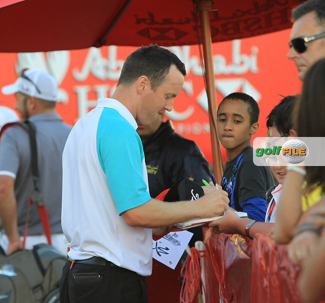 Michael Hoey (NIR) signs autographs after his match during Friday's Round 2 of the Abu Dhabi HSBC Golf Championship at Abu Dhabi Golf Club, 18th January 2013 (Photo Eoin Clarke/www.golffile.ie)