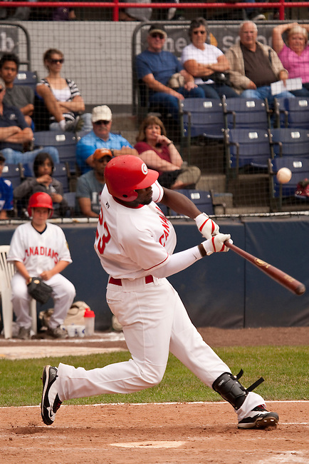 Tuesday, July 14, 2009.  Vancouver left fielder Rashun Dixon hitting the ball in the 6th inning Dixon gets a double with the hit. The Vancouver Canadians went on to win the game against The Boise Hawks 3-2 at Nat Bailey Stadium in Vancouver.   Photo by Gus Curtis.