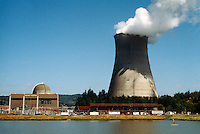 PGE TROJAN NUCLEAR POWER GENERATING PLANT<br /> Cooling Tower Releases Billowing Smoke<br /> First decommissioned pressurized water reactor. Foreground left - generator building, power lines &amp; domed reactor. Cooling tower at right